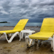 Yellow chairs on beach — Stock Photo