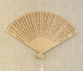 Fan on sackcloth background — Stock Photo