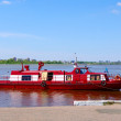 Foto Stock: Life guard-boat on river