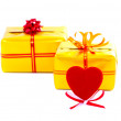 Red heart on gifts back — Stock Photo