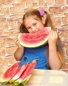 Girl eats melon — Stock Photo
