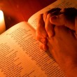 Stock Photo: Bible by candle light