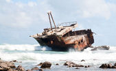 Aghullas shipwreck lying on the rocks — Stock Photo