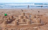 Big sandcastle on the beach — Stock Photo