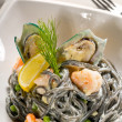 Seafood black spaghetti — Stock Photo