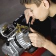 Young mechanic fix engine — Stock Photo #4946094