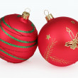 Two red christmas balls isolated on white background — Stock fotografie