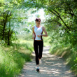 Pretty girl running in the park — Stock Photo #4052151