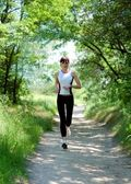 Pretty girl running in the park — Stock Photo