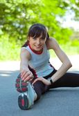 Beautiful Woman Doing Stretching Exercise in the Park — Stock Photo