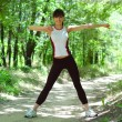 Beautiful Woman Doing Stretching Exercise in the Park — Foto de Stock