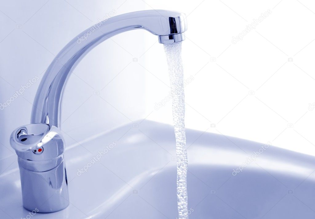 Water flowing from the faucet against the white background — Stock Photo #4522603