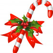 Christmas candy cane decorated with a bow and holly — Stock Vector