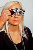 Young woman examining the eyesight — Stok fotoğraf