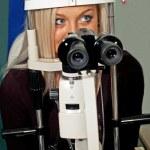 Young woman examining the eyesight — Stock Photo
