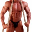bodybuilder posing — Stock Photo #4337388