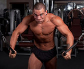 Bodybuilder exercising — Stock Photo
