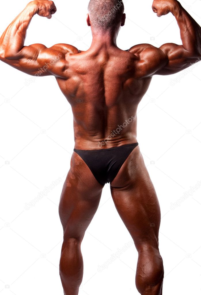 Bodybuilder posing over white background — Stock Photo #4360243