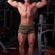 Bodybuilder posing — Stock Photo #4478973