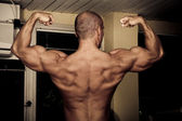 Bodybuilder posing — Photo