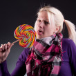 Woman holding lollypop — Stock Photo #5310377