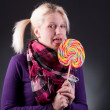 Woman holding lollypop — Stock Photo #5310384