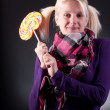 Woman holding lollypop — Stock Photo