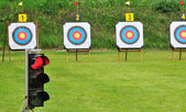 Red lamp and archery targets — Stock Photo