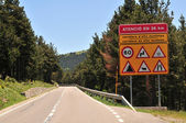 Danger sign by road — Stock Photo