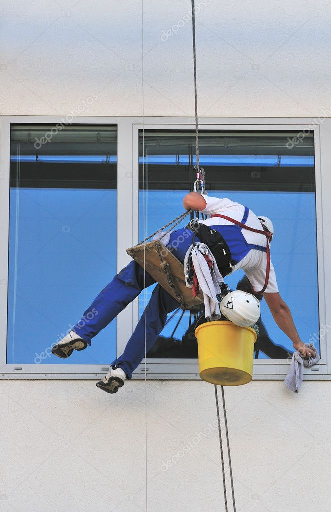 Window washers, cleaning outside on a office building.  Stock Photo #4266997