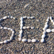 Word sea made of white stones — Stock Photo