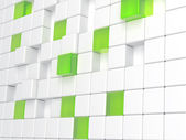 White plastic and green glass cubes — Stock Photo