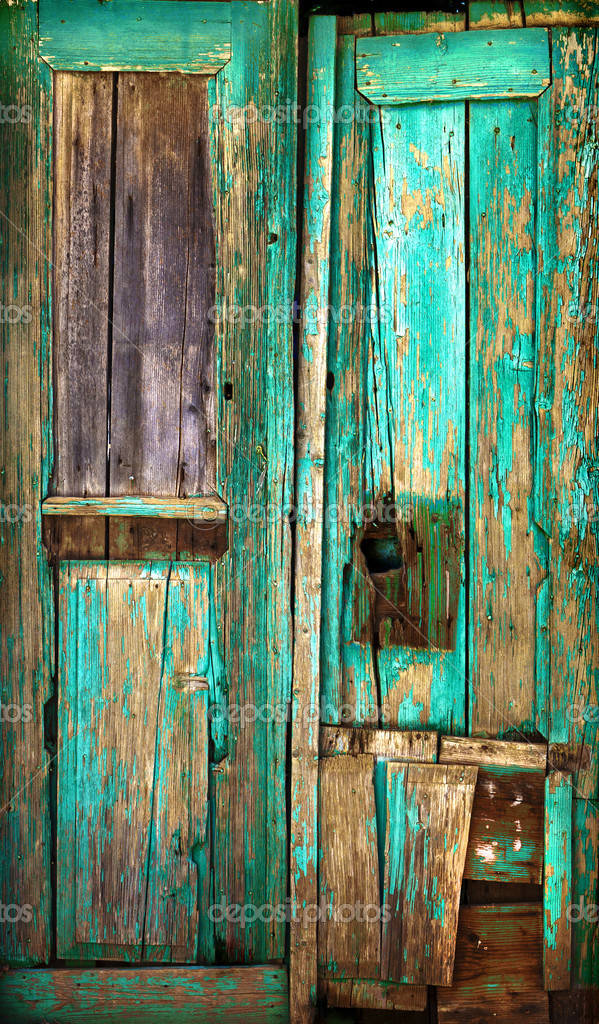 Old wooden door. Old painted wooden boards. Old paint. Background. — Stock Photo #4149810