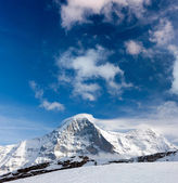 Ski slope in the background of Mount Eiger. — Stock Photo