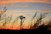 Windmill Sunset with clouds — Stock Photo