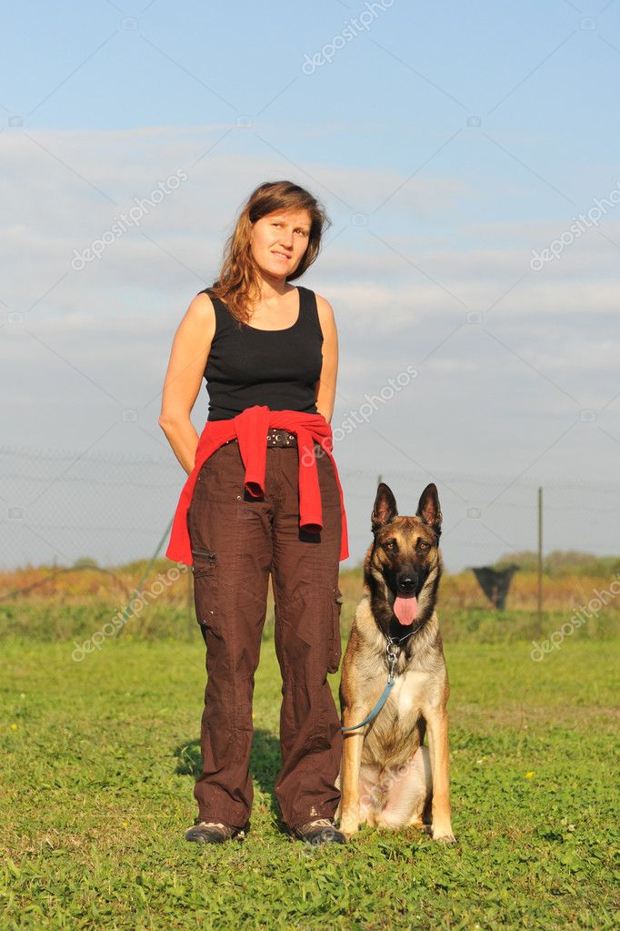 Young woman and her purebred belgian sheepdog malinois — Stock Photo #3999233