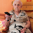 Stock Photo: Senior woman and remote control
