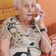 Senior woman and phone — Stock Photo