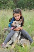 Child and baby wolf — Stock Photo