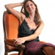 Woman on armchair — Stock Photo