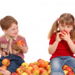 Children with apples on a white background — Stock Photo