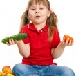 Royalty-Free Stock Photo: The little girl with fruit and vegetables isolated on white back