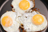 The frying pan with fried eggs — Stock Photo