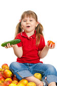 The little girl with fruit and vegetables isolated on white back — Stock Photo