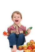 The little boy with fruit and vegetables — Stock Photo