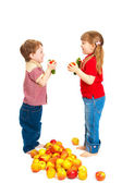 Children with fruit and vegetables isolated on white — Stock Photo
