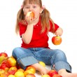 The little girl with apples — Stock Photo