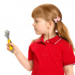 The little girl with a wrench on the white — Stock Photo #4153078