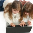 Girls with the laptop on a white background — Stock Photo