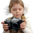 The little girl with the photo camera on the white — Stock Photo #4153136
